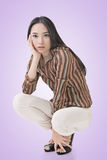 Squat pose by sexy Asian beauty Stock Images