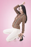 Squat pose by sexy Asian beauty Royalty Free Stock Photo