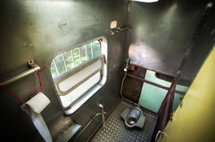 Squat toilet onboard a Thai train Stock Photo