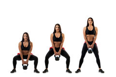 Squat with a weight on the buttocks Stock Photography