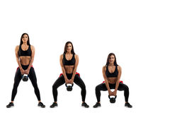 Squat with a weight on the buttocks Royalty Free Stock Photos