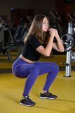Squat woman workout exercise at gym Royalty Free Stock Photos