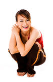 Squating and happy. Woman squatting and laughing happily Stock Image