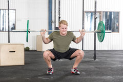 Squats training at fitness gym center Stock Photo