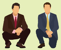 Squatting Businessmen Stock Image