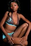 Squatting confident bikini model Stock Image