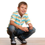 Squatting kid Royalty Free Stock Photos