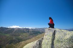 Squatting on the mountain Royalty Free Stock Photos