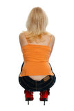 Squatting woman Royalty Free Stock Image