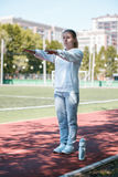 Squatting.young beauty girl do exercises at the stadium Stock Photography