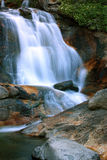 Squaw creek. Water flows through a colorful canyon Royalty Free Stock Photography