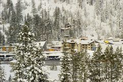 Squaw Valley snow. A view near Squaw Valley, California right after a huge snowstorm showing a number of buildings and homes Royalty Free Stock Images