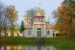 Squeaky Chinese gazebo cloudy October afternoon in the Catherine Park. Tsarskoye Selo, Saint Petersburg. Squeaky Chinese gazebo cloudy October afternoon in the Royalty Free Stock Photo