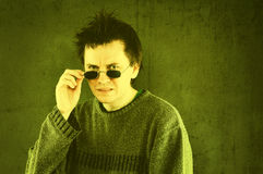Squeamish man. Studio portrait of squeamish man in sunglasses royalty free stock images