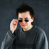 Squeamish man. Studio portrait of squeamish man in sunglasses royalty free stock photography
