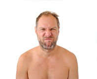 Squeamish men isolated on the white background. Squeamish unshaven man isolated on the white background royalty free stock images