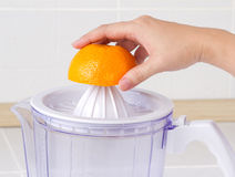 Squeeze juice from orange Royalty Free Stock Image