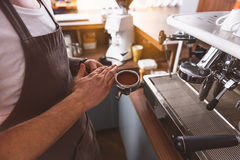 Squeezed coffee beans in the portafilter Stock Images