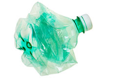 Squeezed green PET bottle. Royalty Free Stock Photos