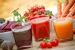 Squeezed juices -  made ​​from organic vegetables Royalty Free Stock Images
