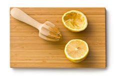 Squeezed lemon fruit and citrus reamer Royalty Free Stock Images