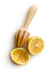 Squeezed lemon fruit and citrus reamer Royalty Free Stock Photography