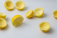 Squeezed lemon peels after making a fresh juice royalty free stock image