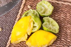 Squeezed lemons and limes. Royalty Free Stock Photo