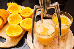 Squeezed orange juice from the glass Royalty Free Stock Images