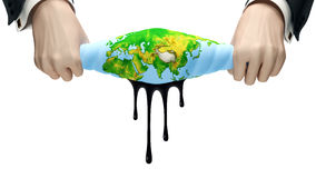 The squeezed out globe. Hands squeeze out globe from which oil exudes Stock Images