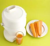 squeezer сока моркови Стоковая Фотография RF
