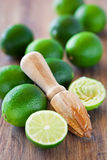 Squeezer and fresh limes Stock Photography