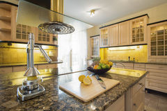 Squeezer on granitic countertop. In modern kitchen stock photo