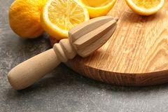 Squeezer and lemons. On dark background Stock Photos