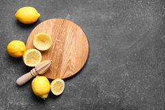 Squeezer and lemons. On dark background Stock Images
