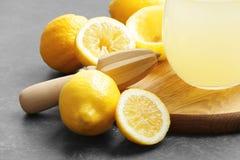 Squeezer and lemons. On dark background Stock Image
