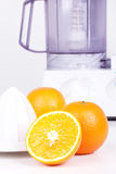 Squeezer and oranges Stock Photography