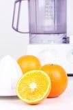 Squeezer and oranges Stock Photography
