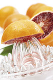Squeezer on sliced blood orange Royalty Free Stock Photography