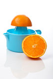 Squeezer and two half orange Stock Images