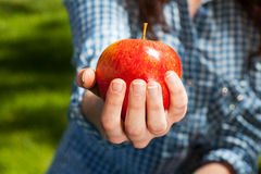 Squeezing an apple Stock Photos