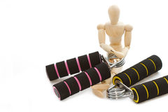 Squeezing hand coil exercise equipment with wooden model Royalty Free Stock Photo
