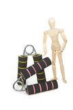 Squeezing hand coil exercise equipment with wooden model Stock Photo