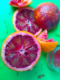 Squeezing juice from blood oranges Royalty Free Stock Photography