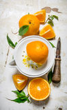 Squeezing juice from fresh oranges . Royalty Free Stock Images