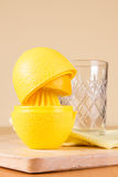 Squeezing the juice of a lemon Royalty Free Stock Photos