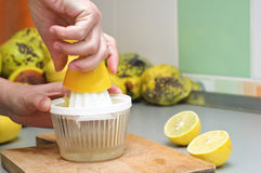 Squeezing lemon stock photos