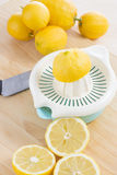 Squeezing lemons Stock Images