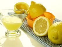 Squeezing lemons for juice,  Royalty Free Stock Photo