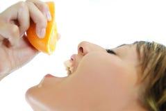 Squeezing orange Royalty Free Stock Images
